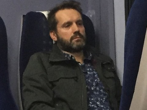 Police hunt train pervert who touched himself in front of female passenger