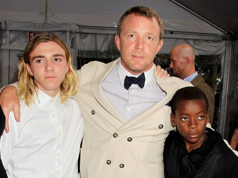 Guy Ritchie proudly hugs his and Madonna's children in family Christmas snap amid 'legal clash'