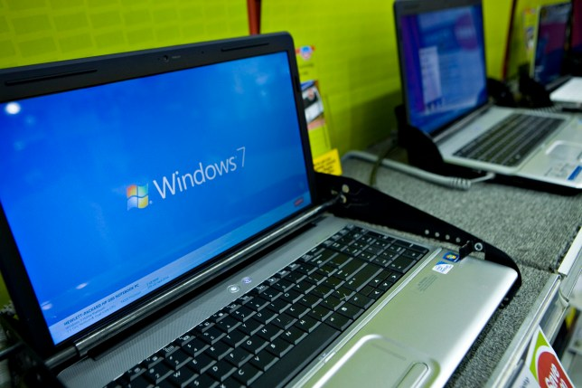 A Windows 7 logo appears on a Hewlett-Packard laptop on display at a Staples store in New York, U.S., on Thursday, Oct. 22, 2009. Microsoft Corp. will begin selling the Windows 7 operating system today, an effort to reverse three quarters of declining Windows sales and fend off Apple Inc.'s gains in personal computers. Photographer: Daniel Acker/Bloomberg