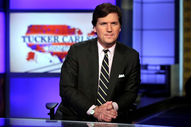 "FILE - In this March 2, 2017 file photo, Tucker Carlson, host of ""Tucker Carlson Tonight,"" poses for photos in a Fox News Channel studio in New York. A partnership between the U.S. Census Bureau and an Islamic civil rights group, which was criticized by Carlson on his show, has ended days after it was announced. A spokesman for the U.S. Department of Commerce ??? the agency that oversees the Census Bureau ??? confirmed Tuesday that the Council on American-Islamic Relations (CAIR) is no longer a formal partner in efforts to promote Muslim American participation in the 2020 Census. (AP Photo/Richard Drew, File)"