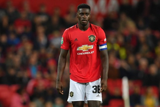 Axel Tuanzebe is set to form part of a three-man defence for Manchester United's clash with Tottenham