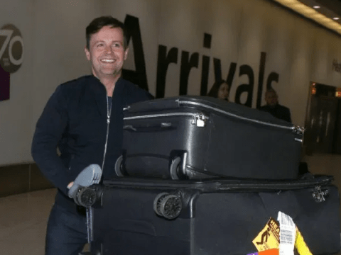 I'm A Celebrity's Declan Donnelly can barely see over top of suitcases as he returns home from jungle
