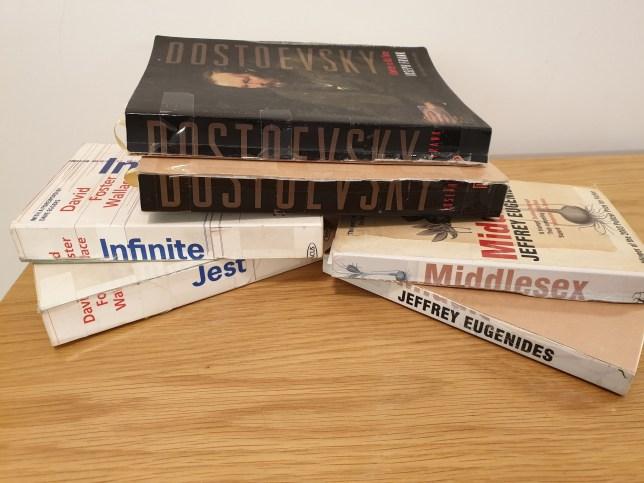 Alex Christofi's books sliced in half