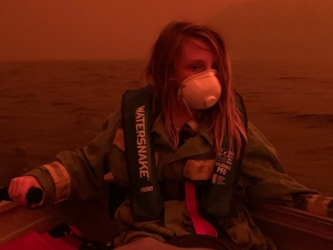 Mum reveals story behind wildfire picture of son, 11, during desperate boat escape