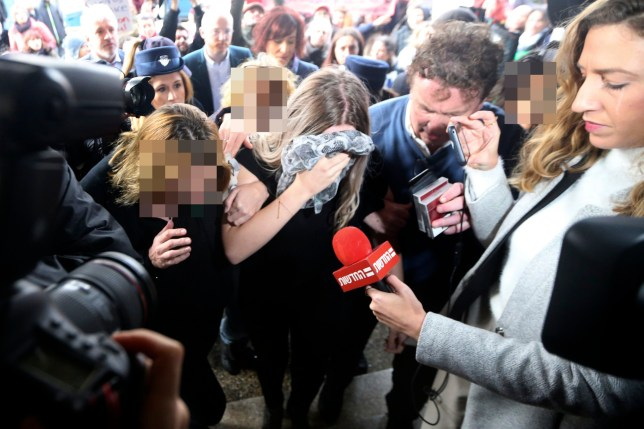 A 19 year-old British woman, center, that was found guilty of making up claims she was raped by up to 12 Israelis arrives at Famagusta District Court for sentencing on Tuesday, Jan. 7, 2020. The woman was found guilty on a charge of public mischief which carries a maximum 1,700 euro fine and one year in jail. The woman insists she was raped and was coerced by investigators to retract her claim.