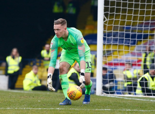 Nathan Bishop picks up the ball during a game for Southend United