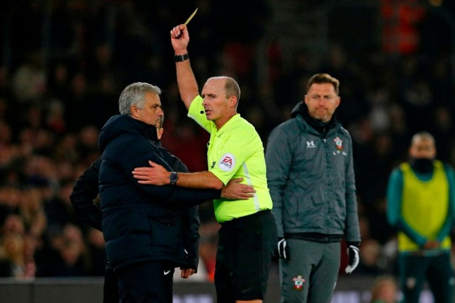 Jose Mourinho is booked by Mike Dean during a Tottenham v Southampton game