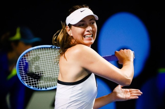 Maria Sharapova hits a forehand during the Brisbane International