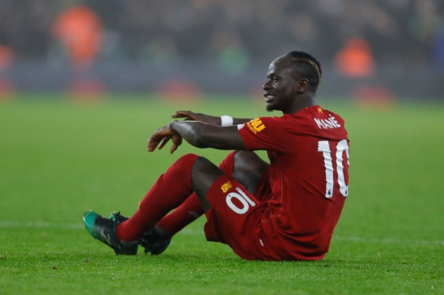 Sadio Mane sits on the turf as he is brought off for Liverpool against Wolves
