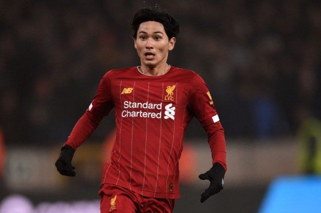 Liverpool's Japanese midfielder Takumi Minamino gestures during the English Premier League football match between Wolverhampton Wanderers and Liverpool at the Molineux stadium in Wolverhampton, central England on January 23, 2020. (