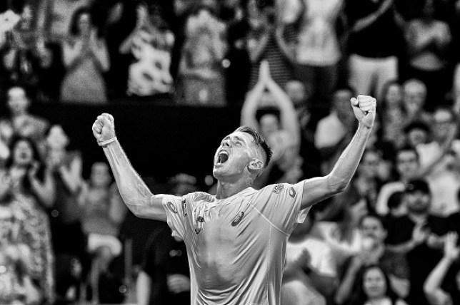 Alex de Minaur celebrates victory for Australia against Germany