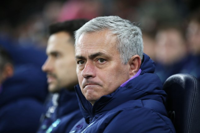 Tottenham Hotspur manager Jose Mourinho looks on while sat on the bench