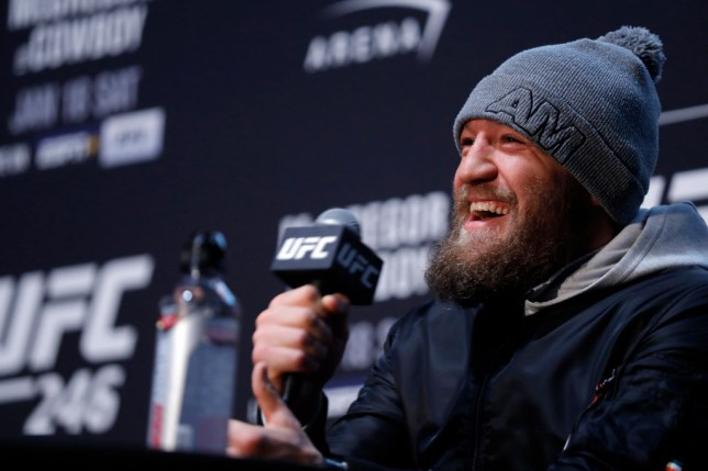 Conor McGregor smiles as he answers questions at a UFC media day