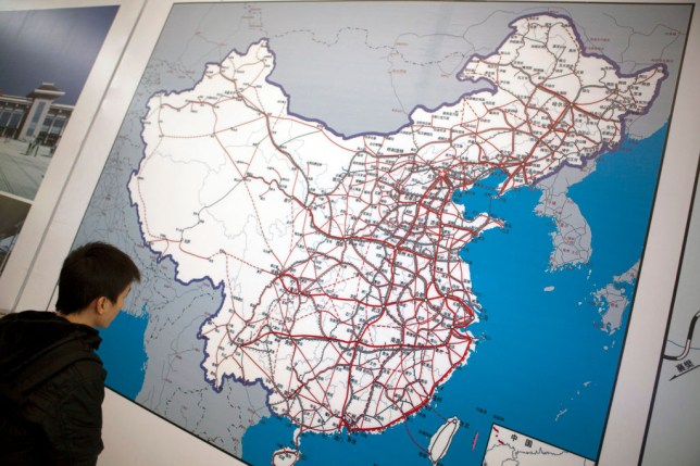A passenger looking at a map of the Chinese rail network