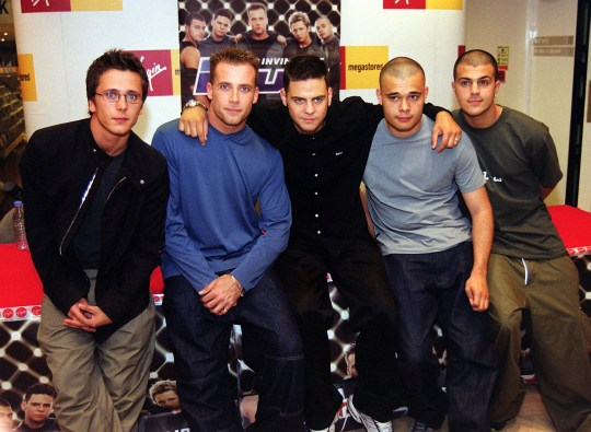 SHOWBIZ Five/album launch...FOR ONE USE ONLY/NO INTERNET USE AND NO SALES Boy band Five, from left to right, Ritchie Neville, Jason Brown, Scott Robinson, Sean Conlon and Richard Breen during a signing of their special edition album 'Invincible' at the Virgin Megastore in Piccadilly, London Monday 24 July 2000. Five's latest single 'We Will Rock You' is currently at No. 1 in the British charts. PA photo: Ian Nicholson....A