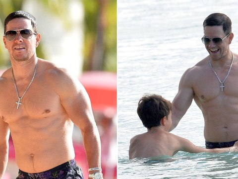 Mark Wahlberg shows off results of six month training regime as he wrestles with son on the beach