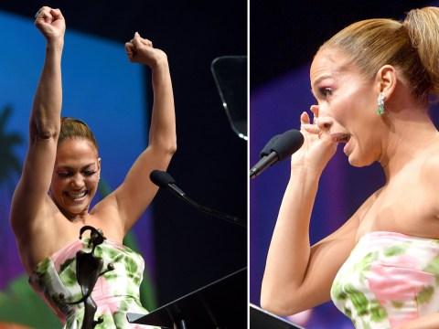 Jennifer Lopez wipes back the tears as she receives Spotlight Award at Palm Springs Film Festival