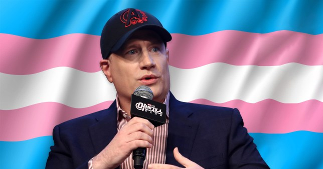 Kevin Feige in front of trans flag