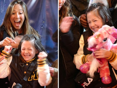 Myleene Klass's daughter wins a pink unicorn at those impossible fairground games and we're impressed