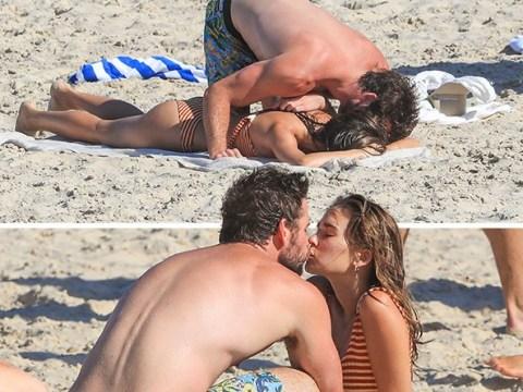 Liam Hemsworth can't keep his hands off new girlfriend Gabriella Brooks during steamy beach PDA sesh