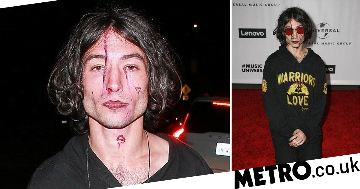 Ezra Miller paints bloody scars onto his face for Grammys afterparty