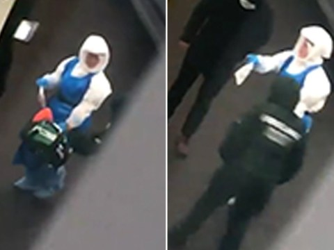 Fears coronavirus has struck UK rise as man is escorted to ambulance by hazmat medic