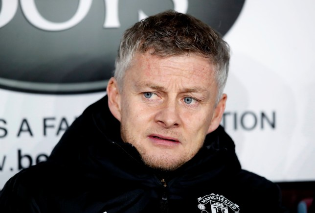 Ole Gunnar Solskjaer looks annoyed sitting on the Manchester United bench