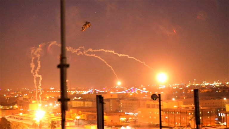In this photo provided by U.S. Department of Defense, the Army's AH-64 Apache helicopter from 1st Battalion, 227th Aviation Regiment, 34th Combat Aviation Brigade, conducts overflights of the U.S. Embassy in Baghdad, Iraq, Tuesday, Dec. 31, 2019. The helicopters launched flares as a show of presence while providing additional security and deterrence against protesters. (U.S. Army photo by Spc. Khalil Jenkins, CJTF-OIR Public Affairs via AP)