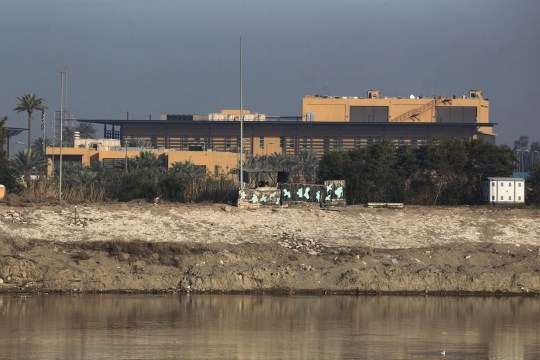 """CORRECTION - A general view shows the US embassy across the Tigris river in Iraq's capital Baghdad on January 3, 2020. - The US embassy in Baghdad urged American citizens in Iraq to """"depart immediately"""", for fear of fallout from a US strike that killed top Iranian and Iraqi commanders. (Photo by AHMAD AL-RUBAYE / AFP) / The erroneous mention[s] appearing in the metadata of this photo by AHMAD AL-RUBAYE has been modified in AFP systems in the following manner: [2020] instead of [2019]. Please immediately remove the erroneous mention[s] from all your online services and delete it (them) from your servers. If you have been authorized by AFP to distribute it (them) to third parties, please ensure that the same actions are carried out by them. Failure to promptly comply with these instructions will entail liability on your part for any continued or post notification usage. Therefore we thank you very much for all your attention and prompt action. We are sorry for the inconvenience this notification may cause and remain at your disposal for any further information you may require. (Photo by AHMAD AL-RUBAYE/AFP via Getty Images)"""