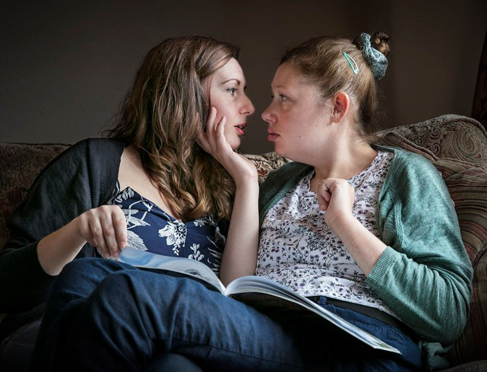 Sisters Jenna and Lauren: Lauren has an unidentified genetic condition that has meant she has a mental age similar to a baby. Jenna reads her sister children?s books which she loves.