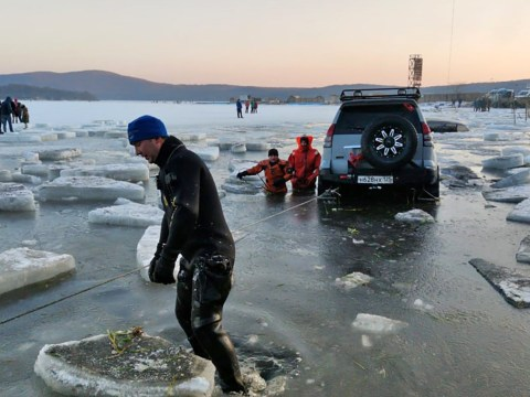 Scramble to rescue dozens of cars which fell through ice into sea