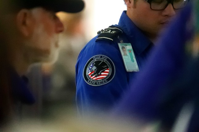 SAN FRANCISCO, CA - JANUARY 22: A transportation security officer with Covenant Aviation Security works at the security checkpoint in Terminal 2 of the San Francisco International Airport on Tuesday, Jan. 22, 2019, in San Francisco, Calif. Covenant Aviation Security has a contract to provide airport security screeners at San Francisco International Airport. (Photo by Aric Crabb/MediaNews Group/The Mercury News via Getty Images)