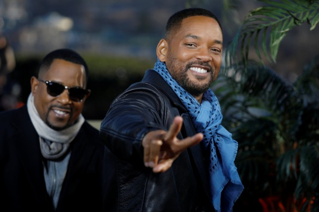 """Cast members Will Smith and Martin Lawrence pose during a photocall for the film """"Bad Boys for Life"""" in Paris, France, January 6, 2020. REUTERS/Charles Platiau"""