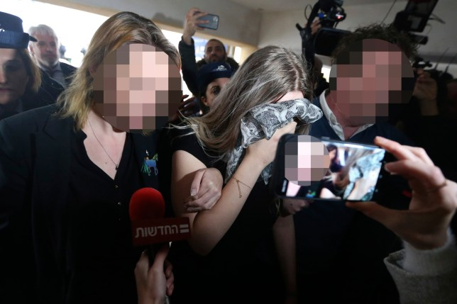 A 19 year-old British woman, center, that was found guilty of making up claims she was raped by up to 12 Israelis arrives at Famagusta District Court for sentencing on Tuesday, Jan. 7, 2020. The woman was found guilty on a charge of public mischief which carries a maximum 1,700 euro fine and one year in jail. The woman insists she was raped and was coerced by investigators to retract her claim. (AP Photo/Petros Karadjias)