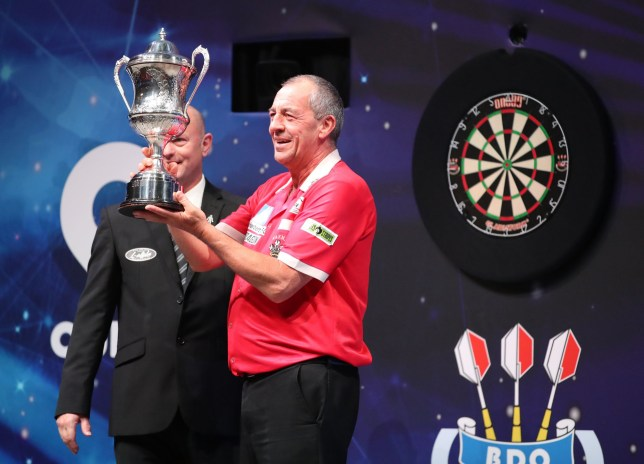 Wayne Warren holds the winners trophy following the mens final of the BDO World Professional Darts Championships 2020 at The O2, London. PA Photo. Picture date: Sunday January 12, 2020. See PA story DARTS London. Photo credit should read: Chris Radburn/PA Wire