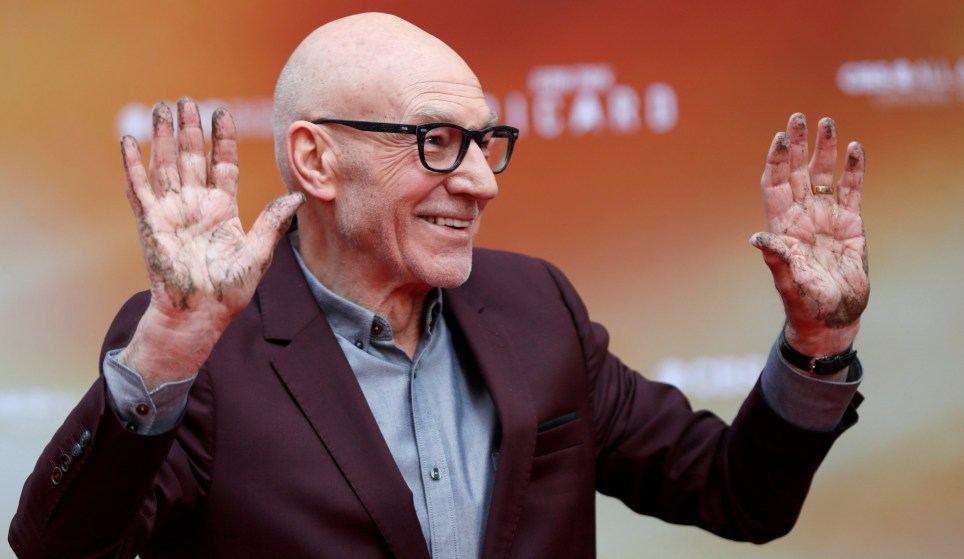 Actor Patrick Stewart poses after placing his handprints in cement at a ceremony in the forecourt of the TCL Chinese Theatre in Los Angeles, California, U.S., January 13, 2020. REUTERS/Mario Anzuoni