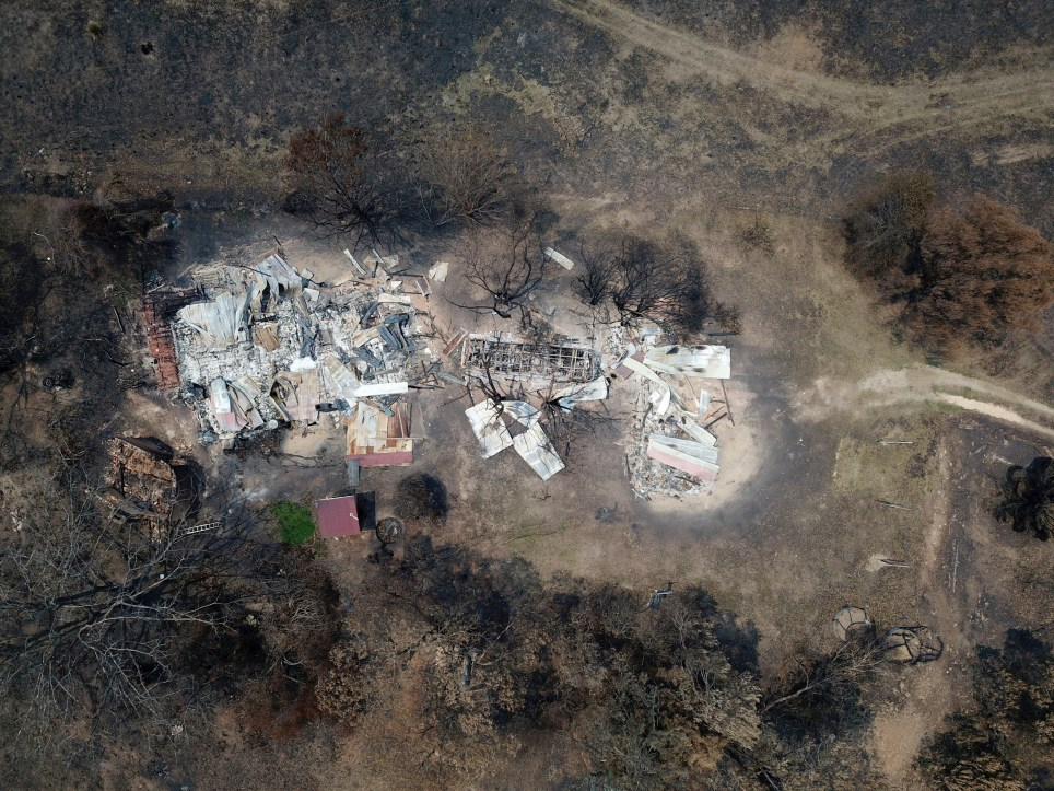 A property at Nerrigundah, Australia, Monday, Jan. 13, 2020, is destroyed after a wildfire ripped through the town on New Year's Eve. The tiny village of Nerrigundah in New South Wales has been among the hardest hit by Australia's devastating wildfires, with about two thirds of the homes destroyed and a 71-year-old man killed. (AP Photo/Sam McNeil)