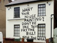 The grafffiti reading 'Want your house painting? Don't be like Terry, pay the bill! Now you will!' on a house on Welbeck Road,in Bolsover, thought to have been painted in revenge by a person employed to paint the house who had not been paid for their work.