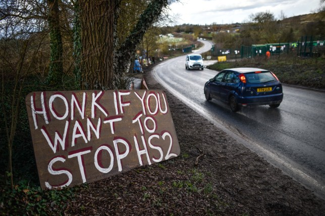 HAREFIELD, ENGLAND - JANUARY 17: A sign reading 'Honk if you want to stop HS2' lies beside the road on January 17, 2020 in Harefield, England. Members of the climate change activist group Extinction Rebellion have joined efforts by HS2 campaigners to prevent woodland and a nature reserve from being demolished. (Photo by Peter Summers/Getty Images)