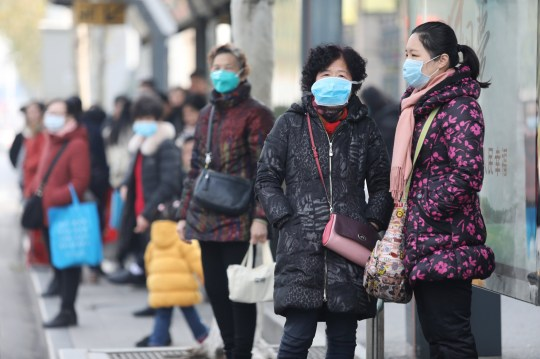 epa08143668 Chinese residents wear masks while waiting at a bus station near the closed Huanan Seafood Wholesale Market, which has been linked to cases of a new strain of Coronavirus identified as the cause of the pneumonia outbreak in Wuhan, Hubei province, China, 20 January 2020. China reported on 20 January an additional death and surge of 139 new confirmed cases of the mysterious SARS-like virus linked to the Wuhan pneumonia outbreak, bringing the total number of cases to 198 with three deaths so far. EPA/STR CHINA OUT
