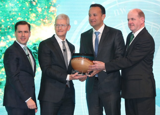 CEO of Apple, Tim Cook is presented the inaugural IDA Ireland Special Recognition Award which celebrates FDI commitment to Ireland at the National Concert Hall in Dublin by IDA CEO Martin Shanahan, Taoiseach Leo Varadkar and Frank Ryan IDA Chairman. PA Photo. Picture date: Monday January 20, 2020. See PA story IRISH Cook. Photo credit should read: Niall Carson/PA Wire