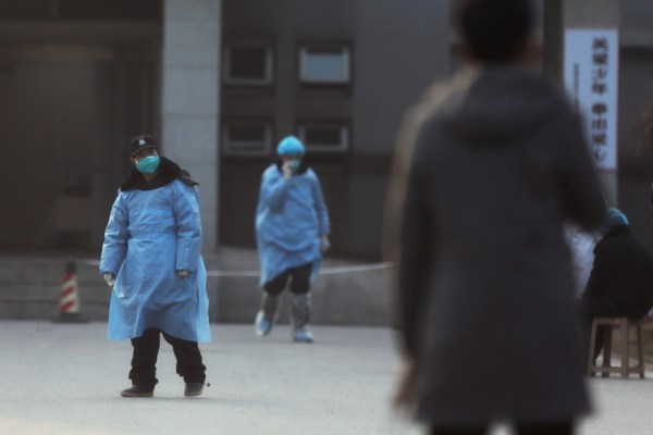 A security personnel wearing a mask is seen at the Jinyintan hospital, where the patients with pneumonia caused by the new strain of coronavirus are being treated, in Wuhan, Hubei province, China January 20, 2020. REUTERS/Stringer CHINA OUT.