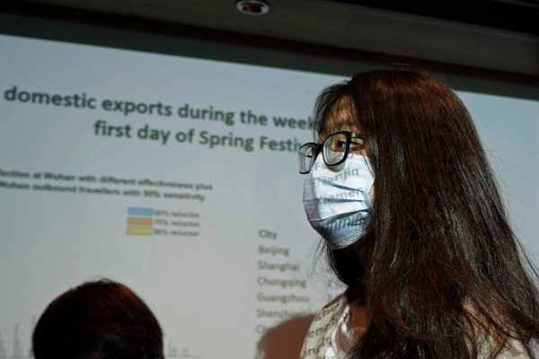 A reporter wearing mask, attends a news conference on the Wuhan coronavirus outbreak, in Hong Kong, Tuesday, Jan. 21, 2020. A fourth person has died in an outbreak of a new coronavirus in China, authorities said Tuesday, as more places stepped up medical screening of travelers from the country as it enters its busiest travel period. (AP Photo/Kin Cheung)