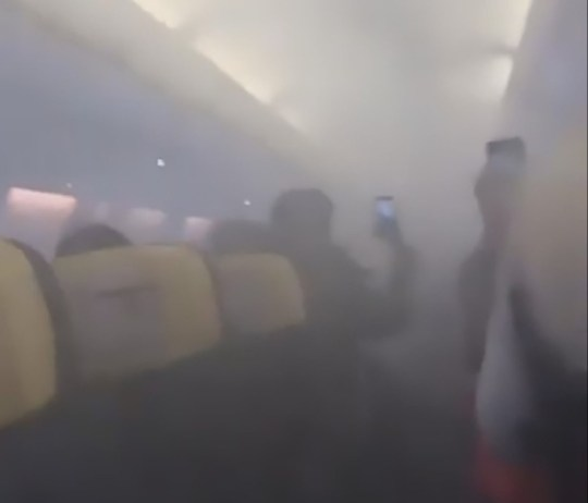Pic Shows: Moment the cabin is full with smoke; A Ryanair flight to Stansted airport had to make an emergency landing after the cabin suddenly filled with thick smoke.