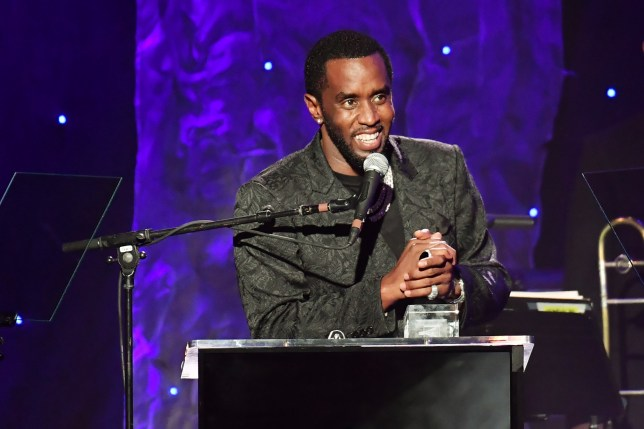 Sean 'Diddy' Combs accepts the President's Merit Award onstage during the Pre-GRAMMY Gala