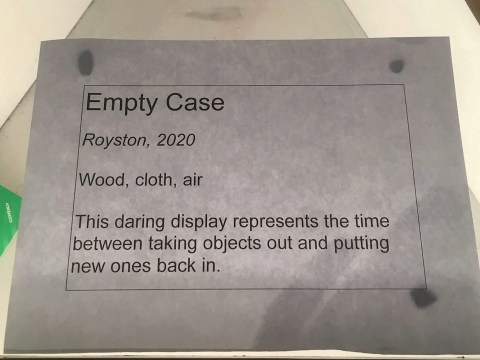 Museum worker gets all the applause for turning an empty display case into a work of art