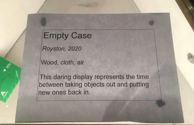 "A museum worker has been hailed as a ""genius"" after turning this empty display case into 'art'"