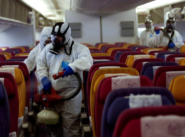 Photo of technicians disinfecting a Thai Airways plane in a bid to halt the spread of coronavirus