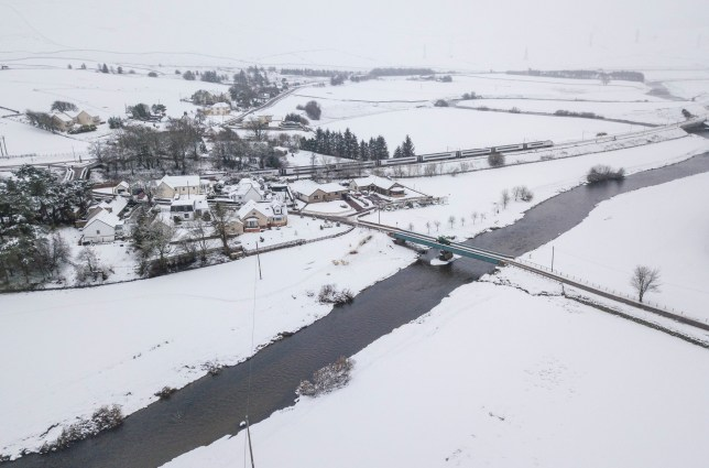 The River Clyde and a snow covered Crawford, South Lanarkshire. Jan 28 2020. ommuters are being warned of travel chaos from ice and snow across Britain today, with three weather warnings having been issued by the Met Office. Overnight temperatures plummeted to some of the lowest so far this winter, while a fresh onslaught of snow and ice means roads could be treacherous. Forecasters are predicting 15cm of snow to fall quickly, with potential for up to 5cm at sea level, with the Highlands expected to face of the brunt of wintry showers. Yellow weather warnings are in place throughout much of Scotland, as well as northern Ireland, until 11am, and a large portion of the west coast of England could be frozen over until 10am. The icy blast will batter large swathes of the country, from Carmarthenshire in Wales to North Yorkshire.