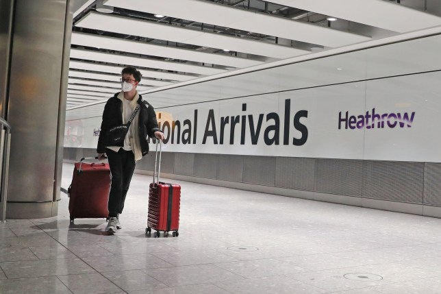 Passengers arrive at Heathrow Airport in London after the last British Airways flight from China touched down in the UK following an announcement that the airline was suspending all flights to and from mainland China with immediate effect amid the escalating coronavirus crisis. PA Photo. Picture date: Wednesday January 29, 2020. See PA story HEALTH Coronavirus. Photo credit should read: Steve Parsons/PA Wire
